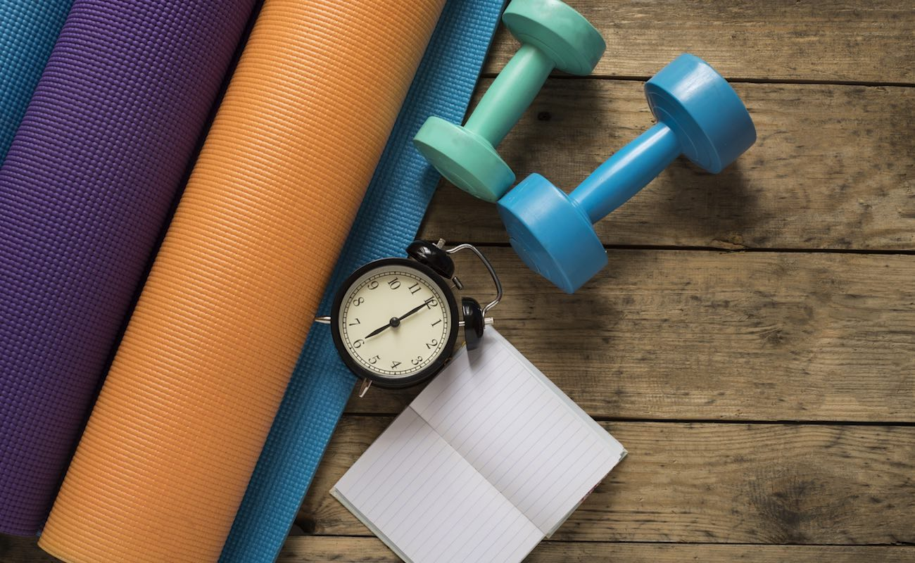 Prepare Fitness with yoga mat and dumbbells